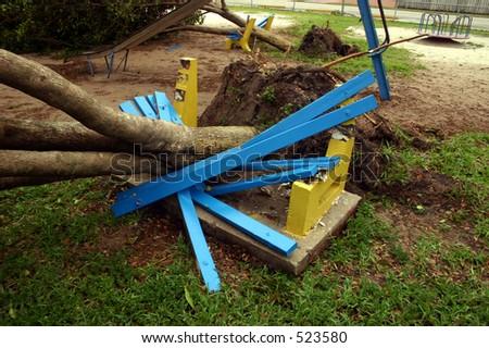 Damage by hurricane Katrina:Two trees fell onto two playground benches; Thursday, Aug. 25, 2005, in Miami Florida. - stock photo