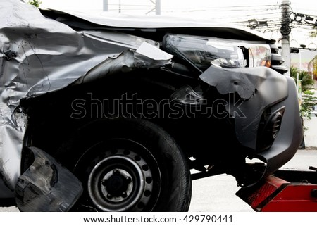 damage car with tow truck - stock photo