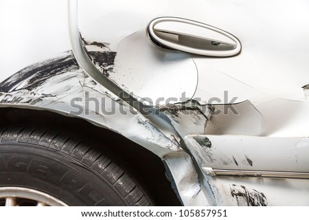 Damage from where a tire rubbed up against and dented the door frame of an automobile. - stock photo