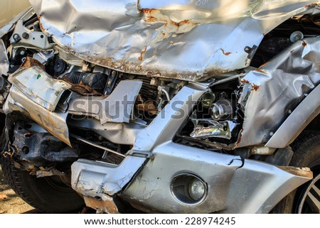Damage to the front of a gold car after an accident. - stock photo