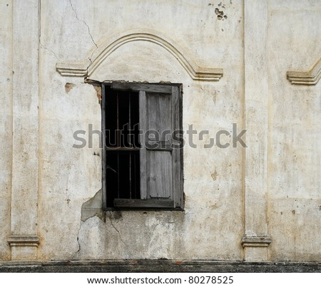 Damage window of ruin building - stock photo