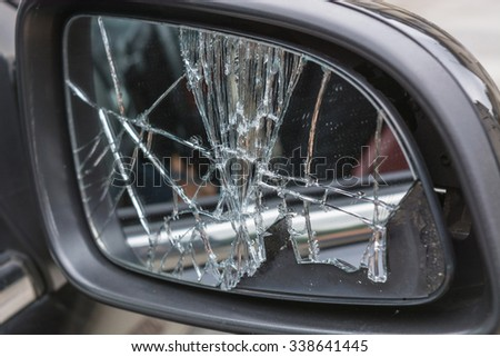 Damaged broken car mirrors - stock photo