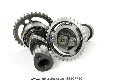 Damaged camshaft gears from a blown motocross motorcycle racing engine - stock photo