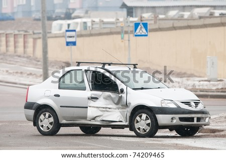 damaged car after crash accident standing on street - stock photo