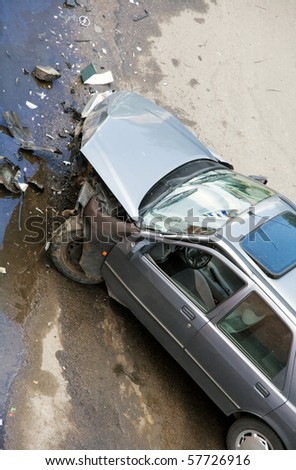 Damaged car after traffic accident - stock photo