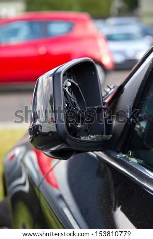 Damaged car mirror - stock photo