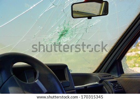 Damaged car window after a crash - stock photo