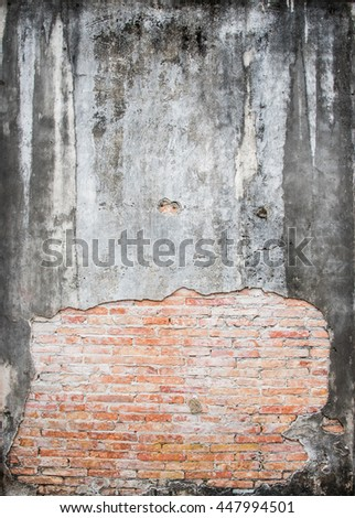 damaged concrete wall, cracked brick wall texture - stock photo
