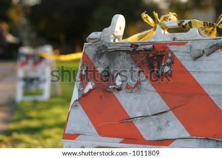 Damaged construction sign in park - stock photo