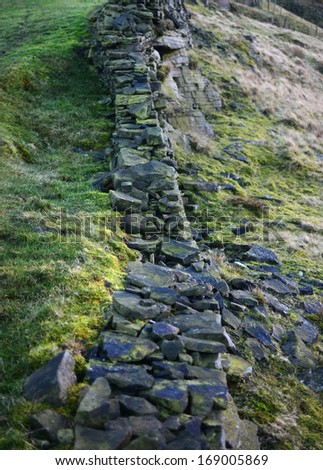 Damaged dry stone wall in the Peak District National Park, England - stock photo