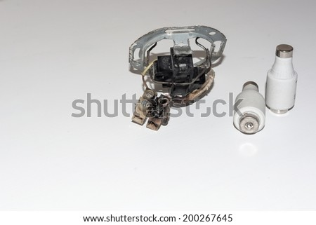 Damaged electrical socket with two electrical fuses