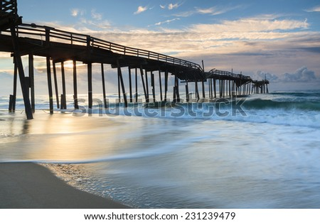Damaged fishing pier on the Cape Hatteras National Seashore in the Outer Banks of North Carolina. - stock photo