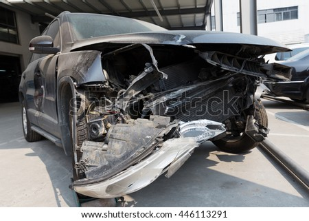 damaged front face of black car