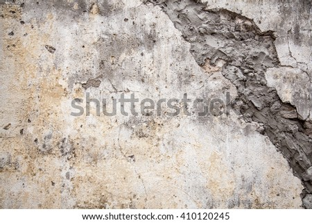 Damaged grungy concrete wall with blank space - stock photo