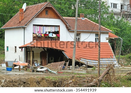 Damaged House After Floods Natural Disaster - stock photo