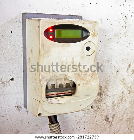 Damaged italian digital electricity meter - stock photo