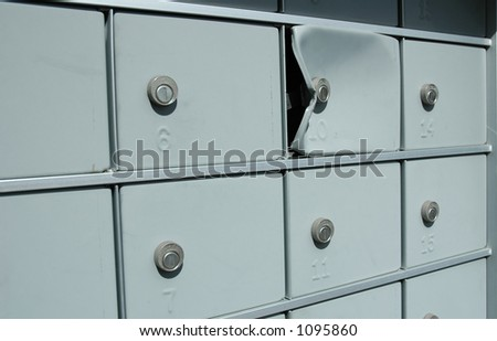 Damaged mailbox broken into by thieves - stock photo