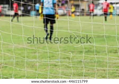 Damaged net of the football field soccer  - stock photo