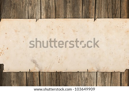 Damaged paper roll on a wooden background - stock photo