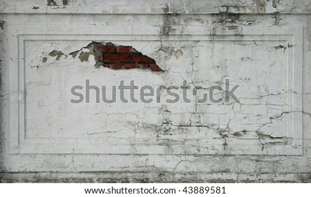 damaged plastered cracked brick wall section for background texture