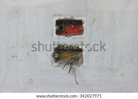Damaged plug of abandoned building. - stock photo