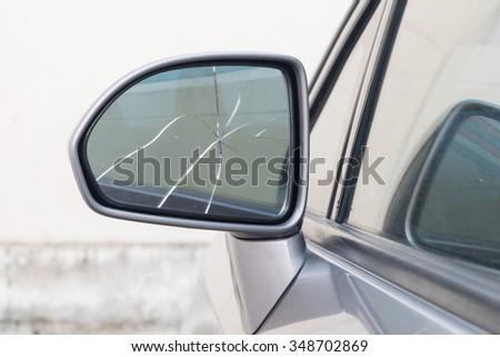 damaged rear view mirror on a car - stock photo