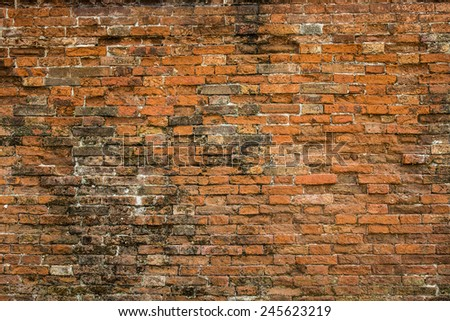 Damaged red brick wall texture - stock photo