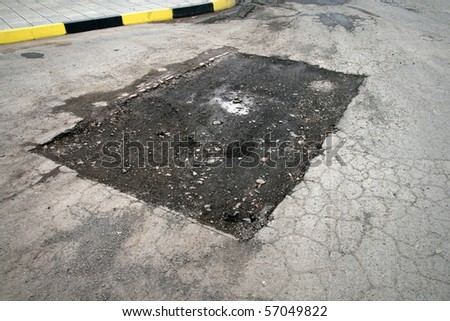 Damaged road - stock photo