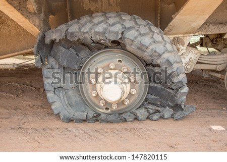 damaged tire - stock photo