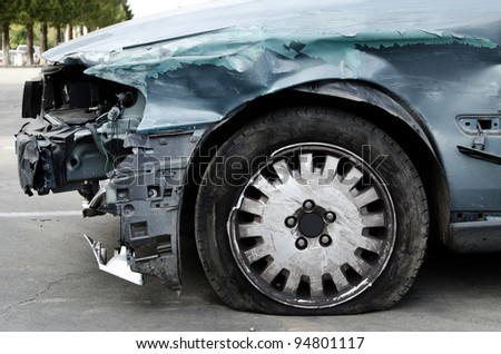 damaged vehicle after crash staying on the street - stock photo
