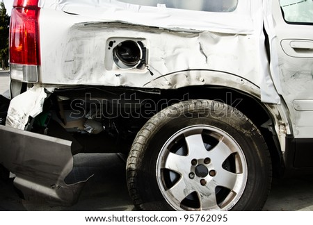 damaged vehicle after crash staying on the street, there is no trade marks on this photo - stock photo
