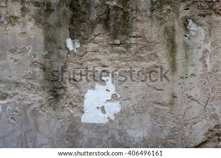 damaged wall with faded, grungy, grey plaster, texture - stock photo