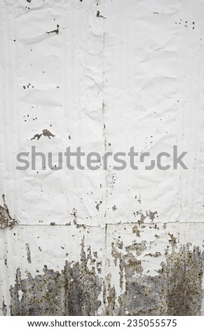 Damaged wall with white paint, construction - stock photo