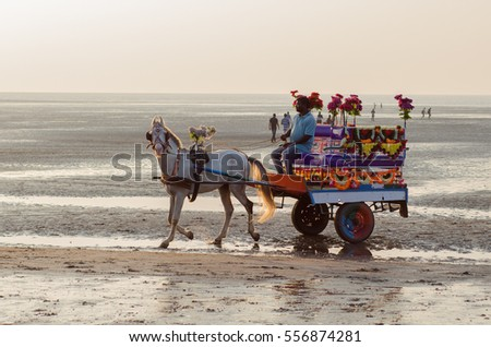 Daman, India - January 7, 2017 : Indian coachman with his Horse carriage, looking for passengers/tourists at Jampore Beach.