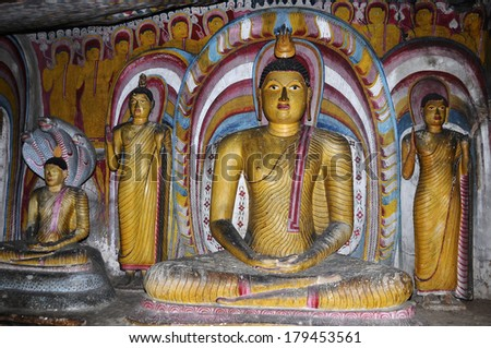 DAMBULLA, SRI LANKA - DEC 31: Cave temple on December31, 2013 in Dambulla, Sri Lanka. Cave temple has five caves under a vast overhanging rock and dates back to the first century BC.