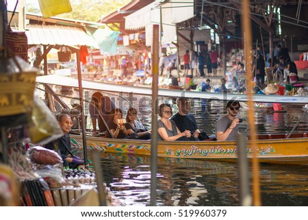 DAMNOEN SADUAK, THAILAND - NOVEMBER 21: Damnoen Saduak Floating Market on Nov 21, 2016. Local people selling goods on the wooden boat. Damnoen Saduak is the most popular floating market in Thailand.