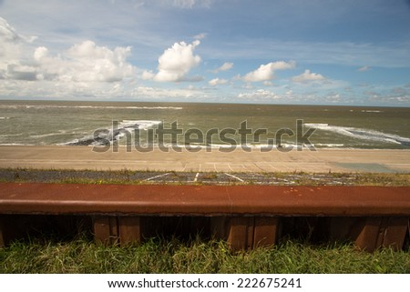 dams on the North Sea netherlands - stock photo