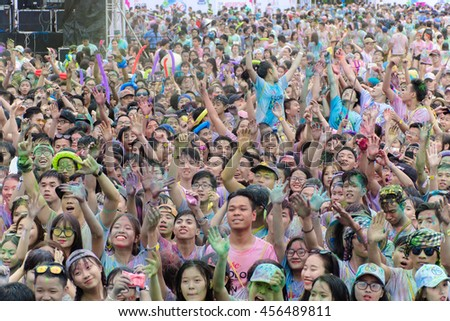 DaNang, Viet Nam - June 2016 : Crowds of unidentified people at The Color Run on June 2016 in Danang, Vietnam. The Color Run is a worldwide hosted fun race with about 1500 competitors in Danang.