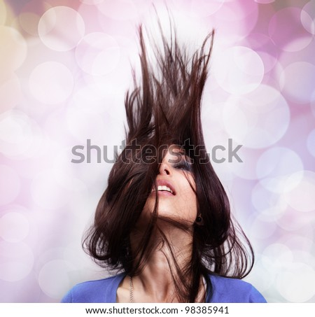 Dance and party concept - sexy woman with hair in motion - stock photo