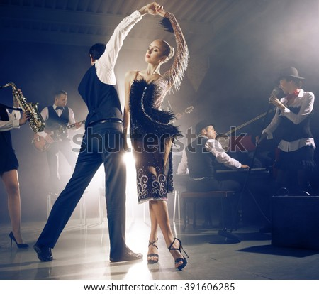Dance couple dancing to a live band sounds - stock photo