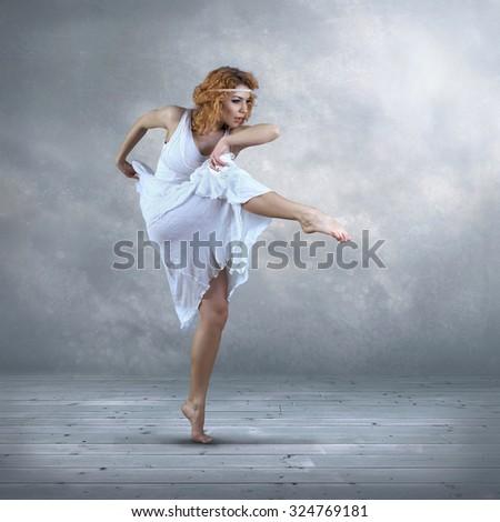 Dance element of ballerina in white dress - stock photo