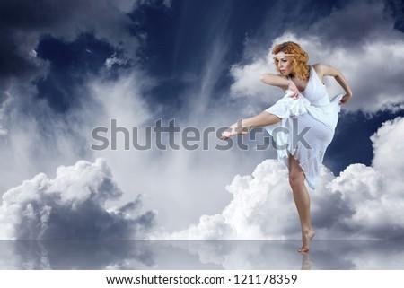 Dance element of ballerina in white under sky - stock photo