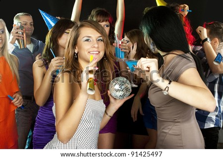 Dance in a disco club - group of friends, men and women dancing to the music having lots of fun - stock photo