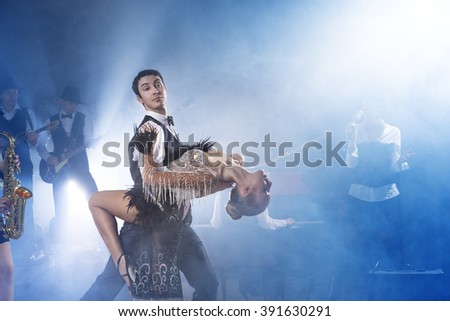 Dance in the final couple pose on a background of jazz - band - stock photo