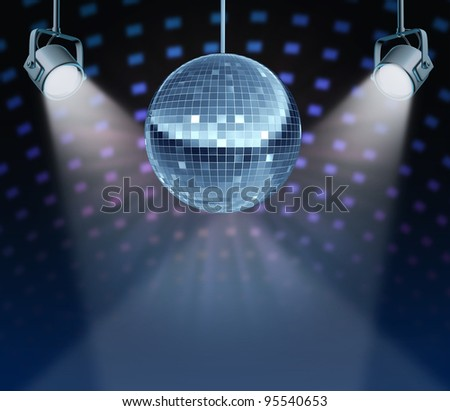 Dance night disco ball as a mirror sphere symbol of fun and dancing party in a nightclub or dance club with glowing stage lights and wall reflexions. - stock photo