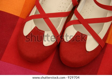 Dance shoes on red cushion - stock photo