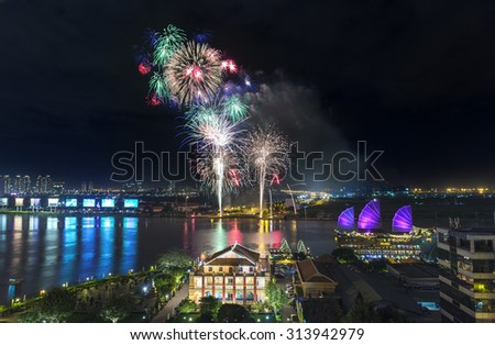 Dance the night flower Saigon river side it's great to watch the fireworks shot up as the desire to reach the shimmering night sky - stock photo