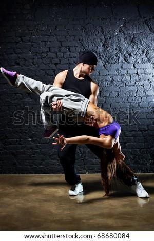 Dancer couple. Contrast colors effect. - stock photo