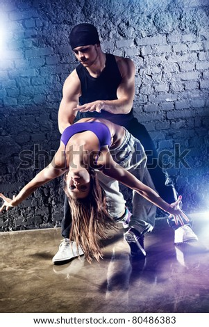 Dancer couple. On wall background.