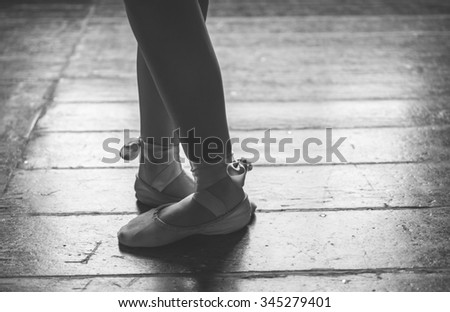 Dancer feet close up. Woman performing ballet poses - stock photo